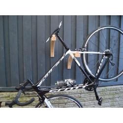 Bike Wall rack in solid steam bended wood.